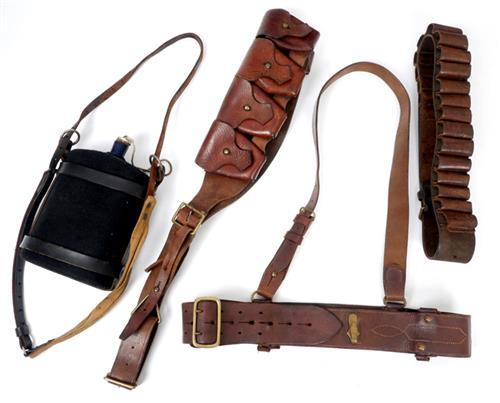 1913-1922 A Sam Browne belt, two bandoliers and a water canteen.