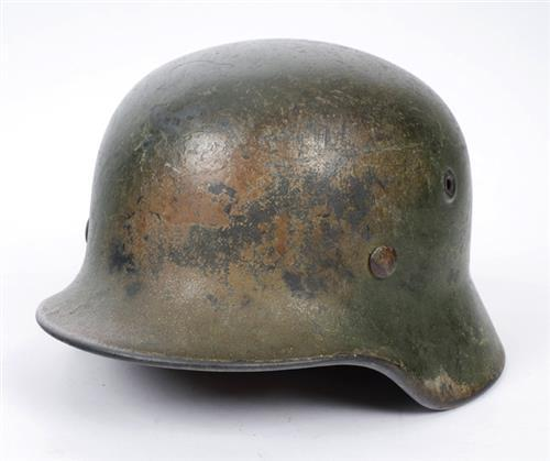 1939-1945 German M42 field-camoflaged helmet.