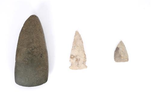 8th century AD polished stone axe head and two Clovis arrow heads.