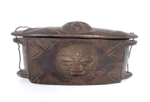 Early 20th century, Angola, Mbunda carved wood medicine chest and lid.