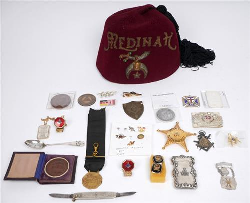 A collection of masonic and fraternal societies'' badges and insignia.