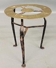 Small wrought iron side table, the top made from an 18th c. brass clock chapter ring. 12