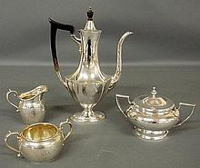 Assembled four-piece sterling silver tea service- teapot with wood handle and finial 11