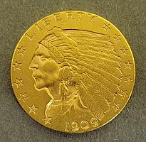 1909 Indian Head two and a half dollar gold coin.