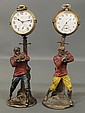 Two paint decorated cast metal early 20th c. football player watch holders each holding an Elgin 15 jewel pocket watch. 7