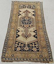 Dagestan oriental hall runner with a cream field, stylized animals and blue border. 7'1