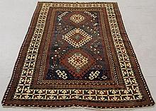 Colorful Kazak oriental carpet with a blue center field, three geometric medallions and ivory border. 5'2