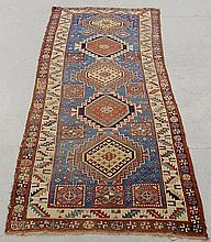 Colorful Kazak oriental hall runner with a blue field and five center medallions. 3'6