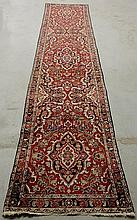 Hamadan oriental hall runner with a red field and floral patterns. 14'6
