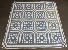 Blue and White Pieced Quilt