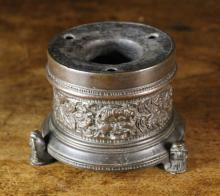 A 16th Century Italian Renaissance Bronze Inkwell with a decorative frieze band intricately cast with scrolling foliage and grotesque face masks, raised on three leonine supports, 3¼ ins (8 cms) in height.