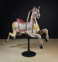 A Fabulous 19th Century Carved & Painted Wooden Fairground Carousel Horse attributed to Friedrich Heyn. The horse now mounted on a metal stand, 60 in (152.5 cms) high, 64 in (160 cms) in length.