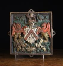An Early 19th Century Painted Cast Iron Armorial Plaque  emblazoned with the arms of The Worshipful Company of Grocers; one of London's Great Twelve City Livery Companies, established in 1345. 14 in (36 cms) square.