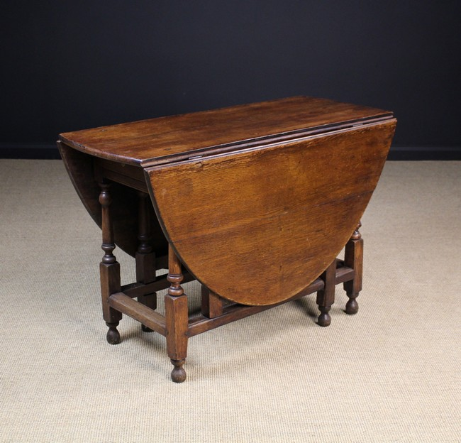 An 18th century oak gateleg table the oval top on turned le - Gateleg table with drawers ...