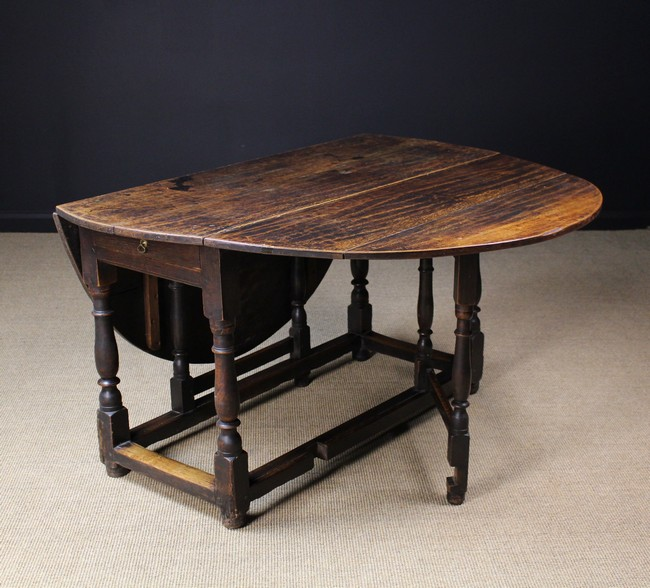 An 18th century gateleg table the oval oak top above a draw - Gateleg table with drawers ...