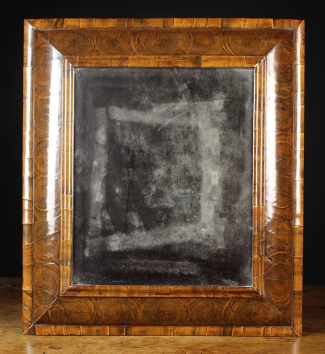 A fine late 17th century olive wood oyster veneered mirror for 17th century mirrors