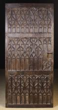 A Late 15th Century Carved Oak Door enriched with Gothic Tracery, 51½ ins x 24½ ins (131 cm x 61 cms).