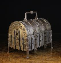 A 19th Century German Dome-topped Steel Casket bound in decoratively pierced straps backed in leather and having a a swing handle to the top and two hasps adorned with square studs flanking a keyhole to the front, 8 ins (20 cms) high [handle down], 10 ins (25 cms) wide, 6½ ins (16.5 cms) deep.