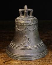 A Bronze Bell Circa 1700, cast with a band of inscription round the top; 'GAETANO GALUPPINI FECE A MCDD', above swagged garlands, bust of Madonnna & child on one side, and a crucifix on the other, 8 ins (20 cms) high.*