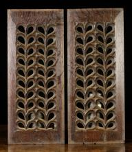 A Pair of Pierced Fretwork Panels of repeated design, 18¾ ins x 8 ins (47.5 cm x 20 cms).