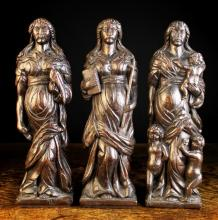 A Set of Three 17th Century Flemish Carved Oak Allegorical Pilasters/Finial Figures personifying Faith, Hope & Charity, 16 ins (40 cms) in height.