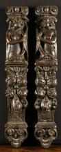 A Pair of 17th Century Flemish Oak Caryatids carved with figures rising above pendant garlands of fruit and foliage, bearing scrolled capitals upon their heads, 23 ins x 3½ ins (58.5 cm x 9 cms).*