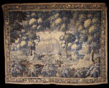 A Large Late 17th/Early 18th Century Flemish Tapestry (A/F). A landscape with flowering shrubs in the foreground, wading birds by a river mid ground and a château with formal garden in the distance viewed through leafy trees either side, 109 ins x 236½ ins (278 cm x 347 cms).