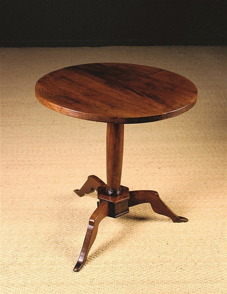 A 19th century walnut manx table the round top fixed to a t for Table th fixed