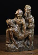 A Fine 16th Century Flemish Oak Carving of The Lamentation of Christ, 15 in x 10 in (39 cm x 25.5 cm).