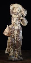 An Early 17th Century Polychromed Relief Carving of Saint John, Circa 1600. The figure depicted carrying a sheep upon his shoulders, 29½ in (75 cm) in height.