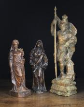 Three 17th Century Carvings: A pine sculpture of Saint Florian stood aside a burning building, 20 in (51 cm) in height. An oak carving of Ceres, goddess of harvest with wheat sheaf and sickle, and another carved oak female figure 12½ in (32 cm) in height.*