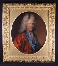An 18th Century Oval Oil on Canvas: Head & Shoulders Portrait of a Bewigged Gentleman, 28½ in x 23 in (72.5 cms x 58.5 cm). Set in an oval gilt mount and late 17th century giltwood frame carved with flowers and clusters of acorns, 38 in x 24 in (96.5 cm x 86.5 cm).