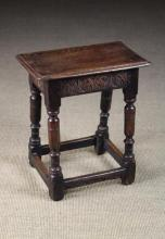 A Mid 17th Century Oak Joint Stool. The edge moulded top above lunette carved rails and marrow-turned legs united by peripheral stretchers, 21½ in (55 cm) high, 19 in x 10½ in (48 cm x 27 cm).
