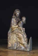 A 16th Century Gilded Oak Retable Carving of The Virgin & Child. Mary depicted seated with the Infant Jesus on her lap, 13½ in (34 cm) high, 8 in (20 cm) in width.