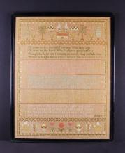 A Large 19th Century Sampler dated 1897, worked on linen with birds, baskets of fruit and flowers, plants and trees above religious verse, in a red currant border, 32 in x 25 in (81 cm x 64 cm).