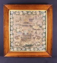 A Delightful Early Victorian Sampler; Anne Roodhouse's Work depicting a tiger, domestic cats sat on stools, birds, a dog, a basket of flowers, a family scene, framed in a border of flowers and foliage, 23½ in x 21 in (60 cm x 51 cm), and set in a deep rosewood frame, 30 in x 28 in (76 cm x 71 cm).