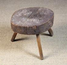 An Early 19th Century Primitive Rustic Stool. The 3½ in (9 cm) thick block top being a cross-section of tree trunk raised on three splayed ash stick legs, approx 13 in (33 cm) in diameter, 12 in (31 cm) high.