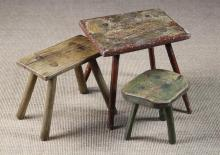 Three Rustic Stools; a 19th century milking stool with residual green paintwork having an elm seat on three ash stick legs 9½ in (24 cm) high, 9½ in x 9 in (24 cm x 23 cm). A rectangular topped stool/table with rectangular top morticed through and wedged with four chamfered legs retaining traces of reddish brown paintwork, 14½ in (37 cm) high, 15½ in x 12½ in (39 cm x 32 cm). A later stool with plank seat on four splayed legs 12 in (31 cm) high, 14 in x 7¼ in (36 cm x 18.5 cm).