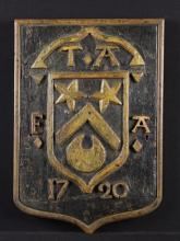 An 18th Century Armorial Panel carved with a raised heraldic shield with initials and date 1720, painted with gilding, 15½ in x 11 in (39.5 cm x 28 cm).