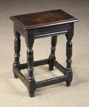 A Good 17th Century Joint Stool. The seat with ovolu moulded edge above run moulded rails standing on marrow turned legs united by peripheral stretchers and terminating on turned feet, 22 in (56 cms) high, 17¾ in (45 cms) wide, 10½ in (27 cm) wide.*