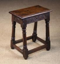 A Good 17th Century Oak Joint Stool with lunette carved rails and astrigal ringed legs united by peripheral stretchers, 21 in (53 cm) high, 17½ in (44.5 cm) wide, 11 in (28 cm) deep.