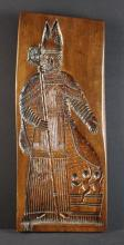 A 19th Century Treen Gingerbread Mould chip carved with Saint Nicholas and tub of three boys, 26¾ in x 10½ in (68 cm x 27 cm).