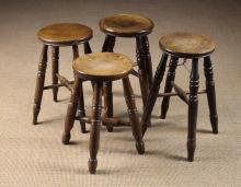 Four Turned Kitchen Stools with round seats above turned legs and X-form stretchers.