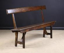 A Georgian Country Pine Bench with open back and chamfer edged plank seat.