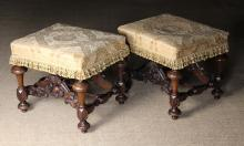 A Pair of Fine William & Mary Upholstered Stools. The seats now covered in a golden cream and eau-de-nil silk flock fabric fringed with tassels, standing on turned and faceted legs united by shaped stretchers with a moulded cross bar to the centre and stylised lion paw terminals, 20 in (51 cm) high, the near square tops 20 in x 21 in (51 cm x 53.5 cm).
