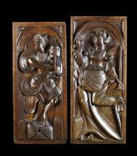 Two Late 16th Century Carved Oak Panels; One depicting Saint Barbara holder a tower 18 ins x 8 ins (46 cms x 20 cms).  The other with a lady dancing holding an arrow in one hand and a heart in the other, 19 ins x 8½ ins (48 cms x 20 cms).*