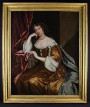 Studio of Sir Peter Lely (1618-1680). A 17th Century OiI on Canvas: Three quarter length portrait of The Duchess of Portsmouth, sat by a draped crimson curtain, wearing a fine brown satin robe adorned with pearls, over a white blouse, with a string of pearls around her neck and a blue cloak, 49 in x 40 in (125 cm x 102 cm). Set in a beaded cavetto moulded gilt frame 57½ in x 48½ in (146 cm x 123 cm).
