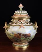 A Large Royal Worcester twin-handled Bulbous Pot Pourri Vase & Cover hand painted with highland cattle in landscape signed John Stinton. The moulded foliate scroll handles enriched with gilding below a decoratively pierced collar swagged in laurel garlands and moulded lid surmounted by a finial knop.  Puce Kerr & Binns device to underside for 1911, Model No 1428, 12 in (30.5 cm) in height.