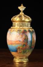 A Fine Quality Royal Worcester Pot Pourri Vase by Walter Sedgley.  The ovoid body hand painted in vibrant colours with continuous Italianate lake-scene and a semi-naked classical figure in the foreground, signed Sedgley. The decorative moulded rim, foot & pierced lid enriched with gilding and surmounted by a finial knop. The base with Kerr & Binns device for 1891, model No. 2048, 9½ in (24 cms) in height.