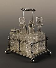 A Six-bottled Silver-plated Cruet Set. The cut